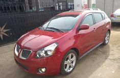 Foreign Used 2009 Red Pontiac Vibe for sale in Lagos.