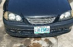 Naija Used Black Toyota Avensis 2000 for 600k ( Sale towards upgrade)