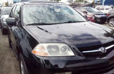 Foreign Used 2002 Black Acura MDX for sale in Lagos.