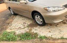 Locally Used 2005 Gold Toyota Camry for sale in Lagos.