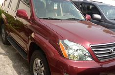 Foreign Used 2009 Red Lexus GX for sale in Lagos.