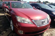 Foreign Used 2010 Maroon Acura MDX for sale in Lagos.