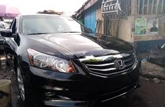 Foreign Used 2010 Black Honda Accord for sale in Lagos.