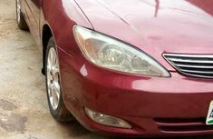 Naija Used 2004 Red Toyota Camry for sale in Lagos.