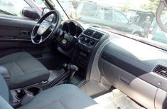 Foreign Used 2004 Model Maroon Nissan Xterra for sale in Lagos