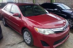 Foreign Used 2013 Maroon Toyota Camry for sale in Lagos.