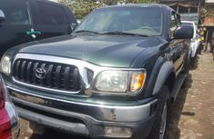 Foreign Used 2003 Dark Green Toyota Tacoma for sale in Lagos.