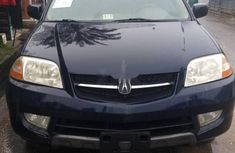 Foreign Used 2004 Dark Blue Acura MDX for sale in Lagos.