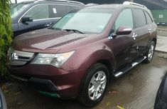 Foreign Used 2008 Maroon Acura MDX for sale in Lagos.