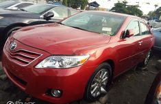 Foreign Used 2011 Red Toyota Corolla for sale in Lagos.