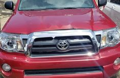 Foreign Used 2007 Maroon Toyota Tacoma for sale in Lagos.