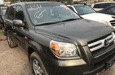 Foreign Used 2007 Dark Green Honda Pilot for sale in Lagos.