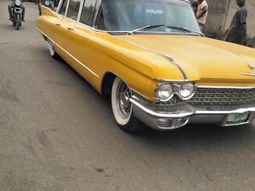 Behold a yellow 1962 Cadillac Fleetwood Limousine spotted in Lagos street