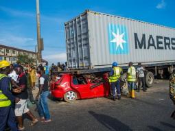 Volkswagen Golf gets under a truck, no fatal damages