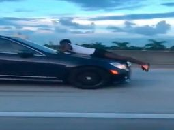 [Video] Man hanging on the hood as ex-girlfriend drives with full speed on the highway