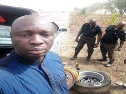 VIRAL!!! Photos of Nigerian policemen helping a man change his tires on a lonely expressway