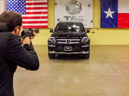Tester unleashes an AK-47 assault riffle while automaker's CEO sits inside