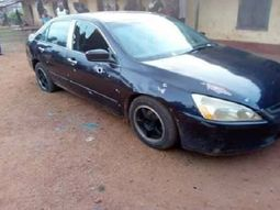 A man in cross river state shows off his car as it's bathed with bullets claimed to be from assassins