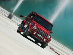 Mercedes G-Class defying gravity as it cruises along a whopping 331-Feet super tall inclined wall