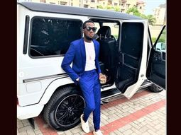 DBanj poses with friends Mercedes-Benz G63 AMG