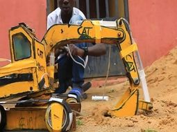 Can you use syringes, batteries & wood to build an Excavator & dump Truck like this Nigerian boy?