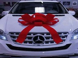 Yomi Casual surprises wife with a new Mercedes Benz SUV as her birthday gift