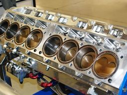 Does an 8-cylinder engine generate lower RPM than a 4-cylinder one?