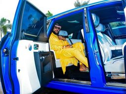 E-Money rides the blue Rolls Royce Phantom he bought for his wife to Islamic festival