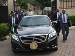 Just like Kim, see how security aides are jogging in the rain alongside Femi Gbajabiamila's official Mercedes