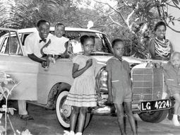 Rare photo of Nigeria's first obstetrician & family posing with their Mercedes Benz car