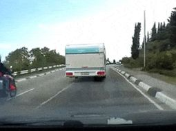 Biker brushes death in careless overtaking (watch video)