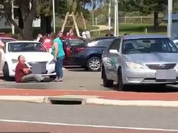 Ridiculous! Australian man reserves car parking spot for his friend by sitting right there