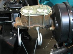 What is brake booster in the car braking system?