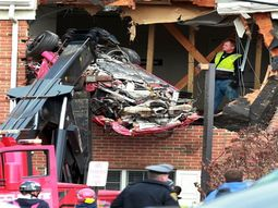 2 men died after speeding Porsche flew to 2nd floor of a nearby building
