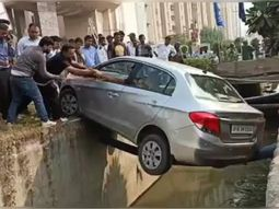 Narrow escape: Passersby rescues driver whose car got stuck over ditch