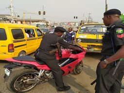 Okada ban: Lagosians stop policemen from seizing man's power bike