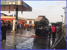 [Photos] LASEMA helps put off a raging fire in a Lagos petrol station