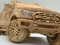 Check out this wooden Ford Range Raptor carved out with working chassis