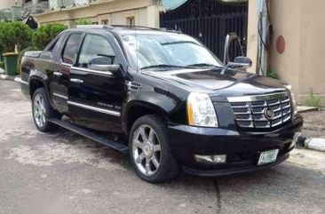 A Bought brand new used 2012 Cadillac Escalade EXT for sale