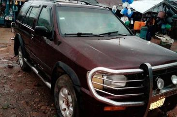 Sell well kept red 1998 Nissan Pathfinder automatic at mileage 84,136