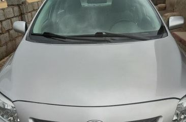 Need to sell high quality grey 2010 Toyota Corolla automatic in Abuja
