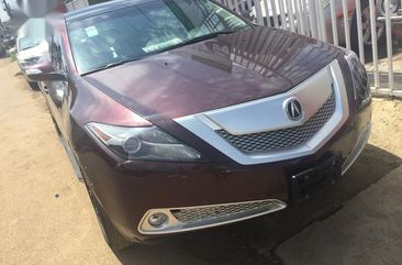 Red 2010 Acura MDX sedan automatic for sale in Ikeja