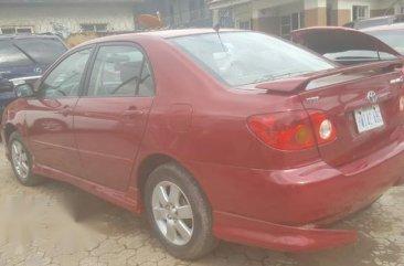 Sell well kept red 2005 Toyota Corolla sedan in Ikeja
