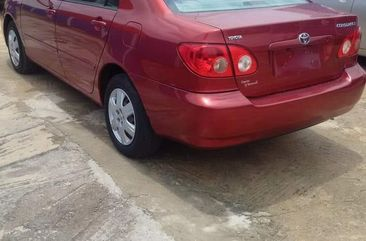 Nigeria Used Toyota Corolla LE 2004 Model Red for Sale