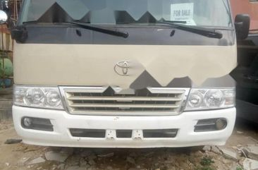 Clean Tokunbo Toyota Coaster 2008 Model Gold