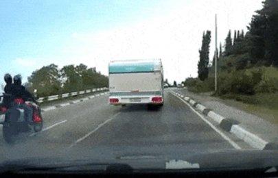 Biker brushes death in careless overtaking (watch video)