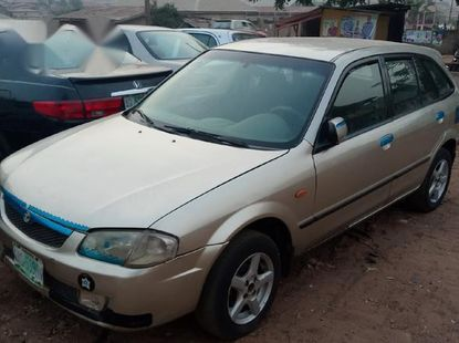 Clean Mazda 323f 2002 Gold For Sale