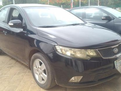 Well maintained black 2009 Kia Cerato automatic for sale at price ₦1,800,000