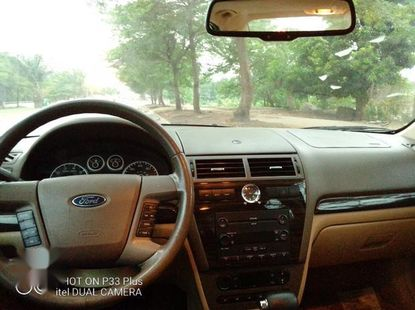 Sell gold 2007 Ford Fusion automatic at cheap price