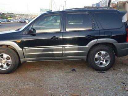 Used black 2001 Mazda Tribute suv / crossover automatic for sale